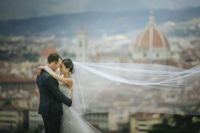 Newlyweds hug overlooking the cathedral of Florence