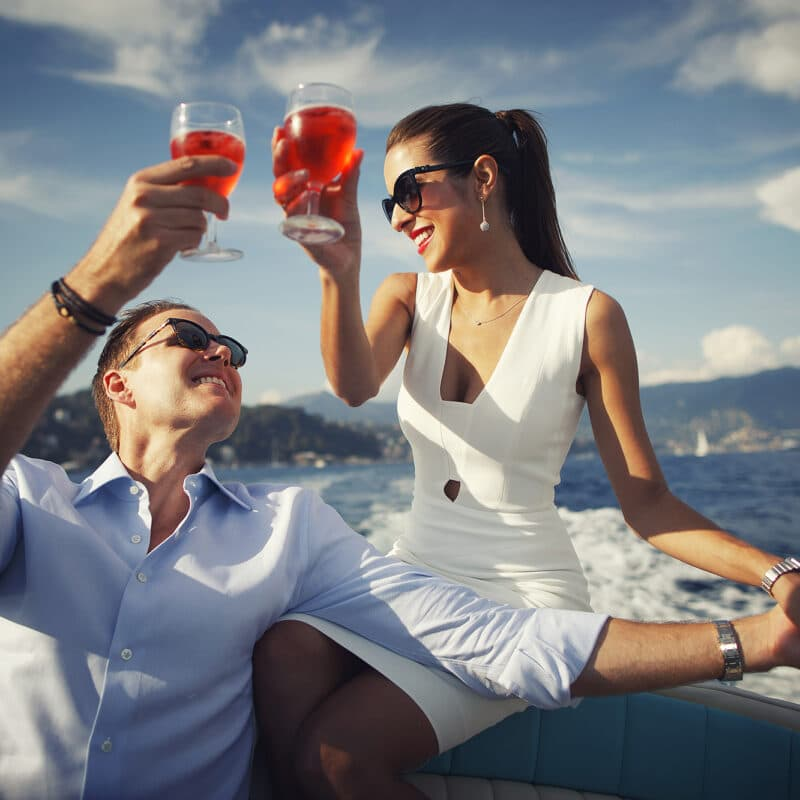 The newlyweds toast on a boat in Portofino