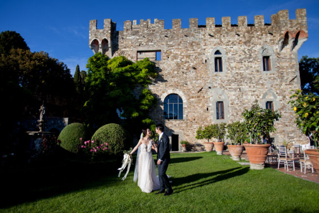 The newlyweds at their wedding in a romantic castle garden in Tuscany