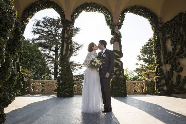 Kiss of the newlyweds in Villa del Balbianello Lake Como