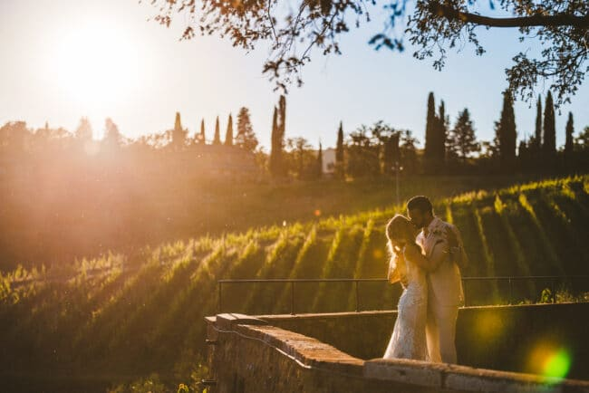 Romantic wedding portrait with vineyards view in Tuscany