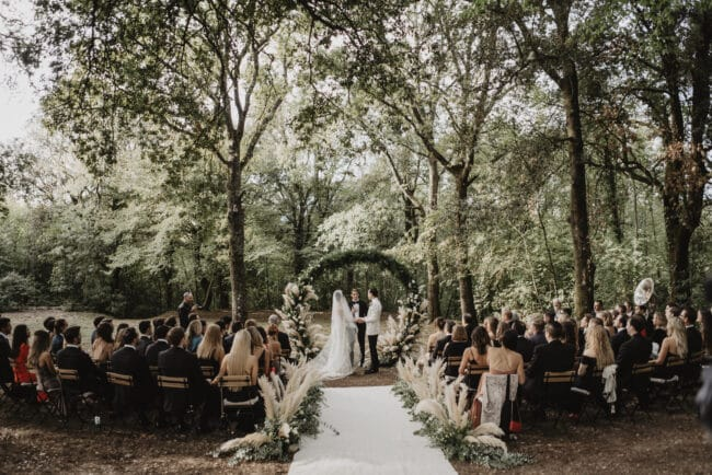 Ceremony in a secret garden in Italy with round arch