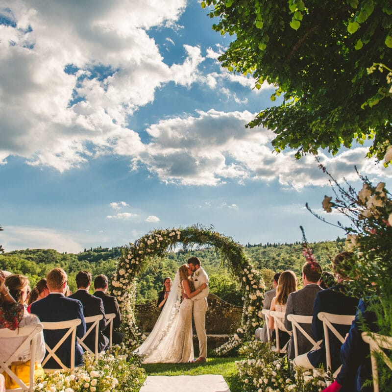 Romantic outdoor ceremony with round arch