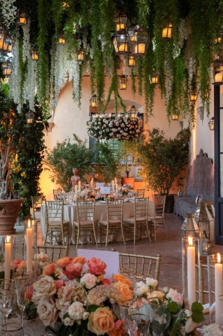 Romantic wedding decor with hanging greenery and candles