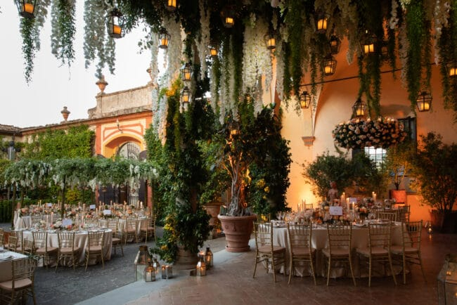 Wedding banquet with cascading greenery and hanging candles