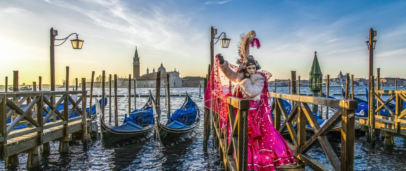 Gondola and Carnival mask in Venice at sunset