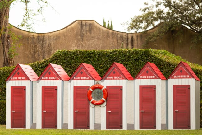 Red and white cabanas for a wedding brunch
