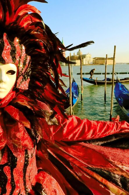 Themed wedding in Venice with Red Carnival mask