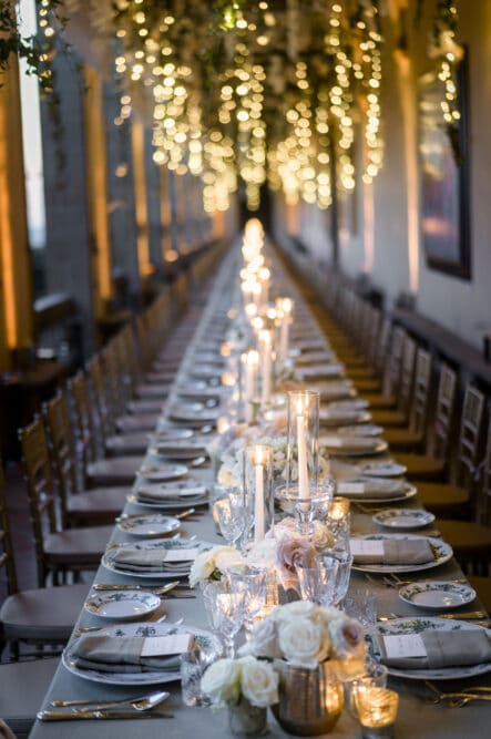 Wedding dinner table with hanging greenery and fairylights