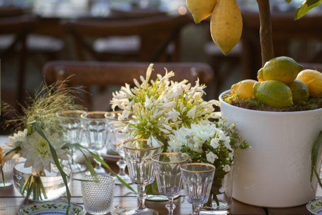 Table with lemon plant and white flowers