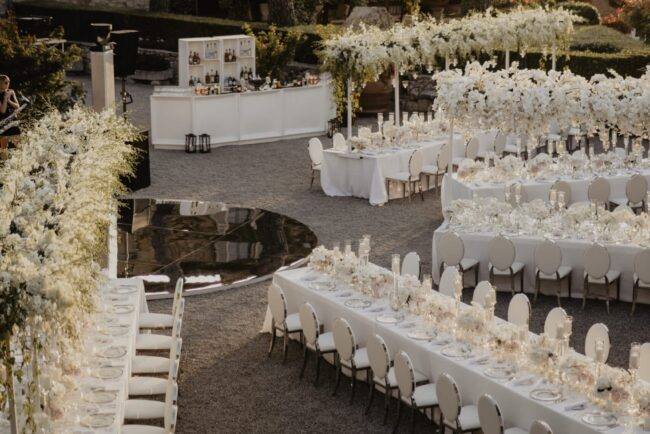 All in white wedding table decorations at sunset