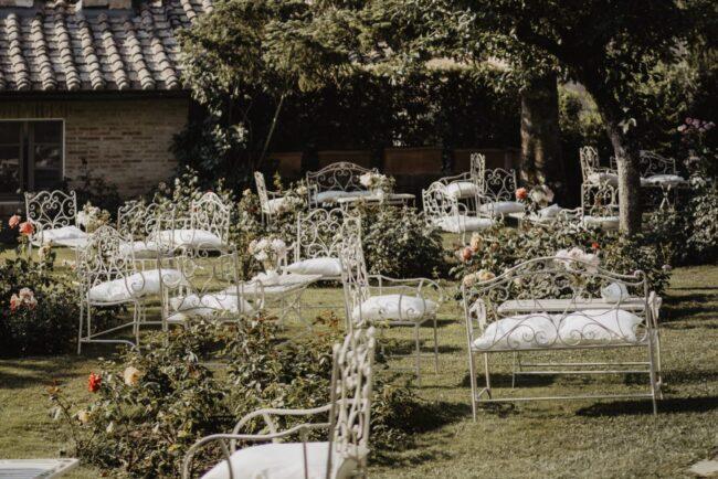 Garden cocktail reception with white iron sofas