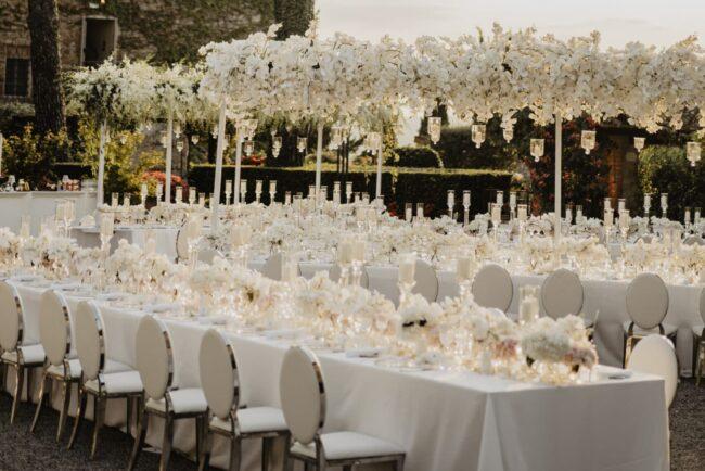 All white wedding table setting for dinner