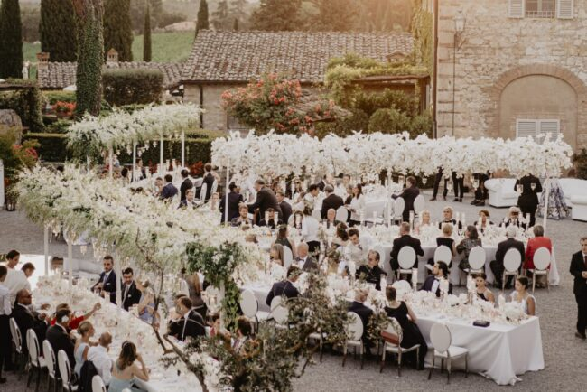 WEdding dinner at the sunset with white tables