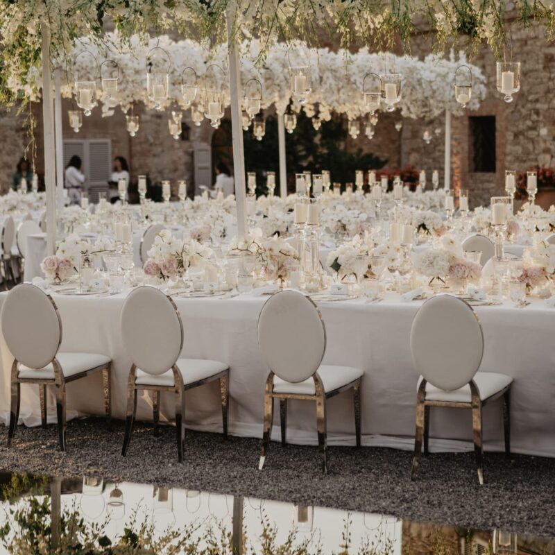 Wedding banquet decor with cascading orchids and hanging candles