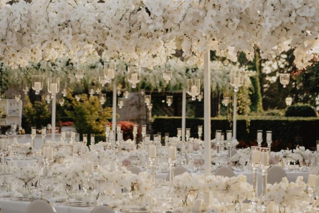 White tables with cascading orchids