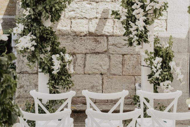 White chairs for outdoor ceremony