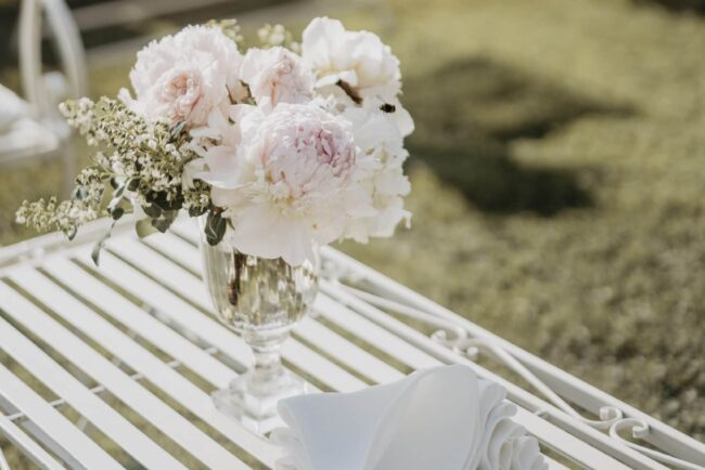 White iron sofa and flower decors for cocktail reception