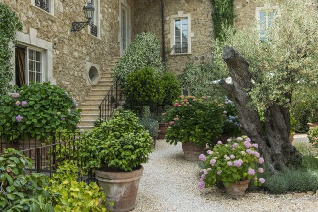 Tuscan style garden with vases and plants