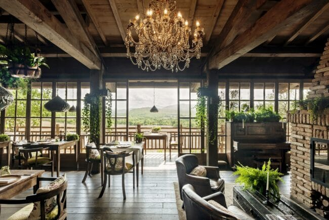 Restaurant with chandelier and glass doors