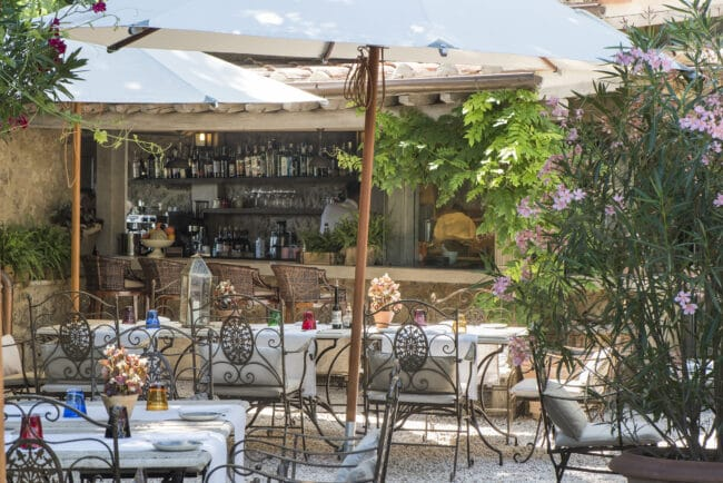 Outdoor trattoria with iron chairs
